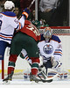 Edmonton Oilers goalie Nikolai Khabibulin (35) stops a shot by Minnesota Wild forward Nick Johnson (25) during period one at the Excel Energy Center in Saint Paul, MN. Minnesota Wild 1 and Edmonton Oilers 1.