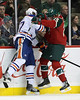 Minnesota Wild forward Nick Johnson (25) and Edmonton Oilers defenseman Tom Gilbert (77) collide during period one at the Excel Energy Center in Saint Paul, MN. Edmonton Oilers 1 and Minnesota Wild 0.