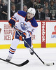 Edmonton Oilers defenseman Ladislav Smid (5) with a shot on net during period one at the Excel Energy Center in Saint Paul, MN.  Edmonton Oilers 1 and Minnesota Wild 0.