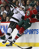 LA Kings forward Jordan Nolan (71) checks Minnesota Wild defensemen Marco Scandella (6) into the boards during period three at the Excel Energy Center in Saint Paul, MN. Scandella took exception to this check and dropped his gloves to fight Nolan.   LA Kings 4 and Minnesota Wild 0.