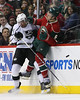 LA Kings forward Jordan Nolan (71) checks Minnesota Wild defensemen Marco Scandella (6) into the boards during period three at the Excel Energy Center in Saint Paul, MN.  LA Kings 4 and Minnesota Wild 0.