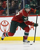 Minnesota Wild defensemen Tom Gilbert (77) brings the puck up the ice in his first game in a Minnesota Wild uniform during period three at Excel Energy Center in Saint Paul, MN.  LA Kings 4 and Minnesota Wild 0.