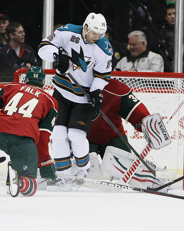 San Jose Sharks forward Michal Handzus (26) blocks Minnesota Wild goalie Niklas Backstrom (32) from San Jose Sharks defenseman Dan Boyle (22) that scored in period one at the Excel Energy Center in Saint Paul, MN.  Minnesota Wild 1 and San Jose Sharks 1.