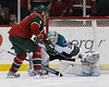 Minnesota Wild center Mikko Koivu (9) lifts one past San Jose Sharks goalie Antti Niemi (31) during the shoot out at the  Excel Energy Center in Saint Paul, MN.  Minnesota Wild 5 and San Jose Sharks 4.
