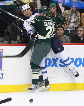 Minnesota Wild forward Erik Christensen (26) checks Winnipeg Jets forward Blake Wheeler (26) into the boards during period one at the  Excel Energy Center in Saint Paul, MN.   Minnesota Wild 1 and Winnipeg Jets 0.