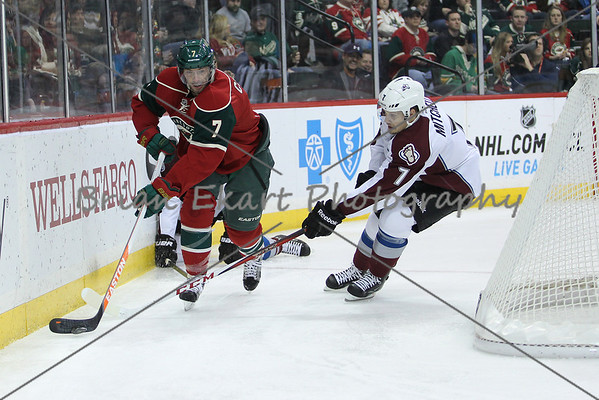 Minnesota Wild forward Matt Cullen (7) with puck behind the net as Colorado Avalanche forward John Mitchell (7) looks on during the first period.  On February 14 at the Minnesota Wild game versus Colorado Avalanche at the Excel Energy Center in St. Paul, MN.