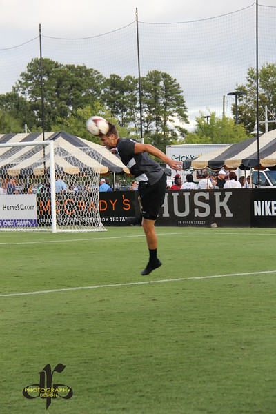 Taylor Mueller heads the ball during warmups