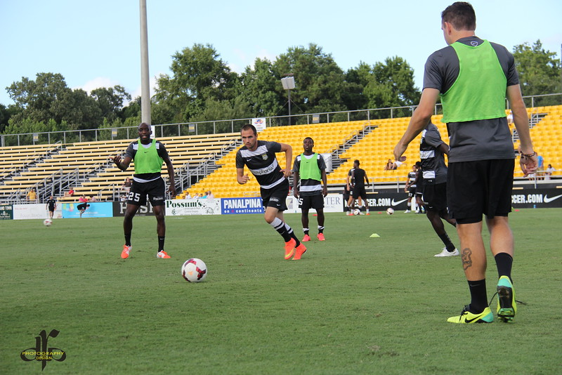 John Wilson, Zach Prince, Emmanuel Adjetey, and Colin Falvey during warmups