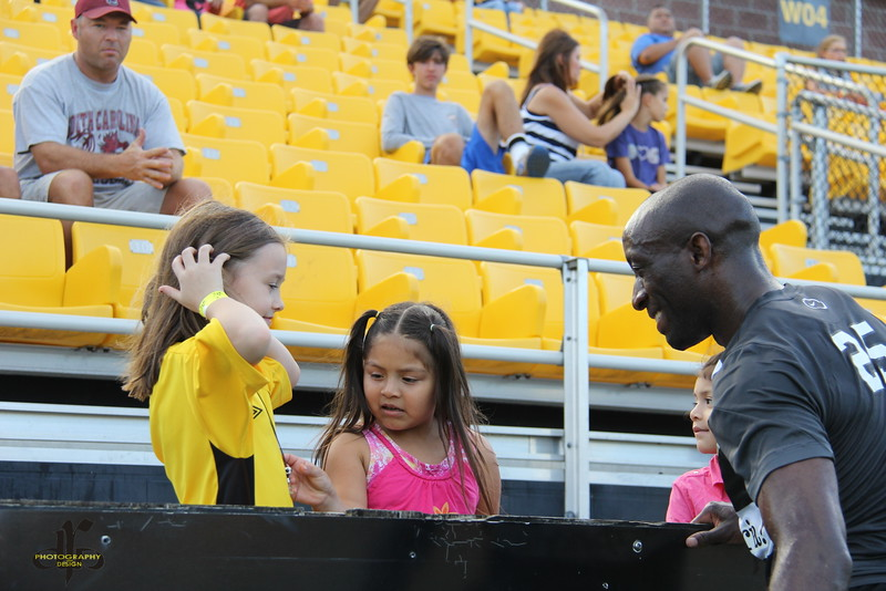 John Wilson spending time with young fans