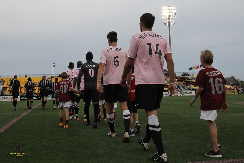 Walk onto the pitch for Kick for a Cure night