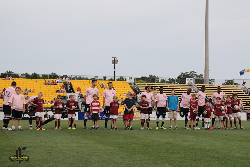 Team lineup for Kick for a Cure night at Blackbaud Stadium
