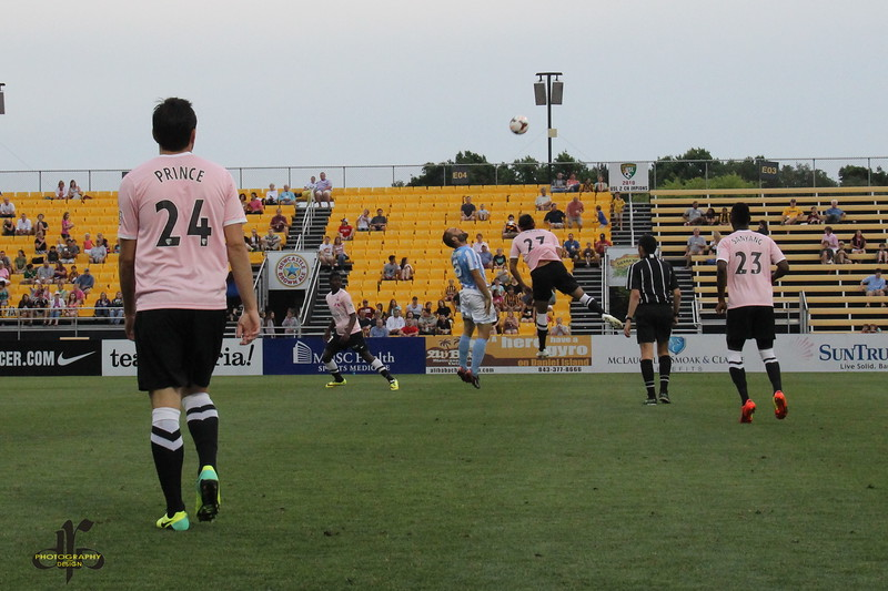 Adam Mena going up for a header