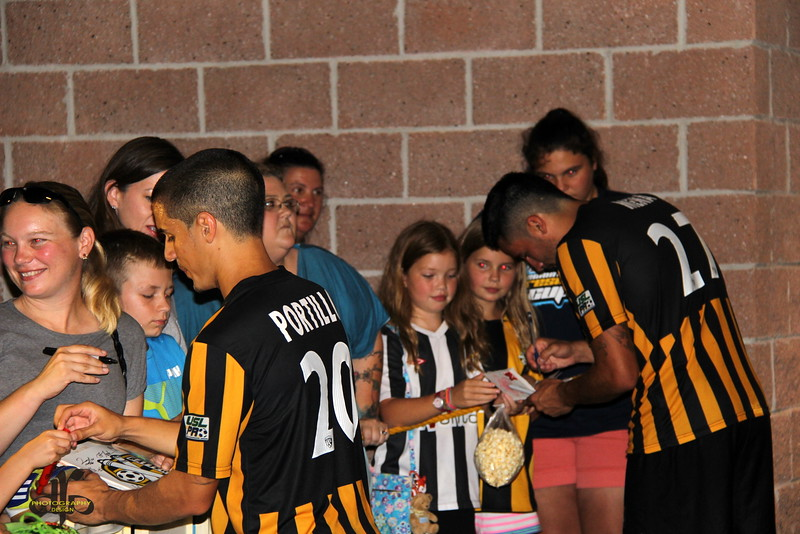 Justin Portillo and Adam Mena sign autographs