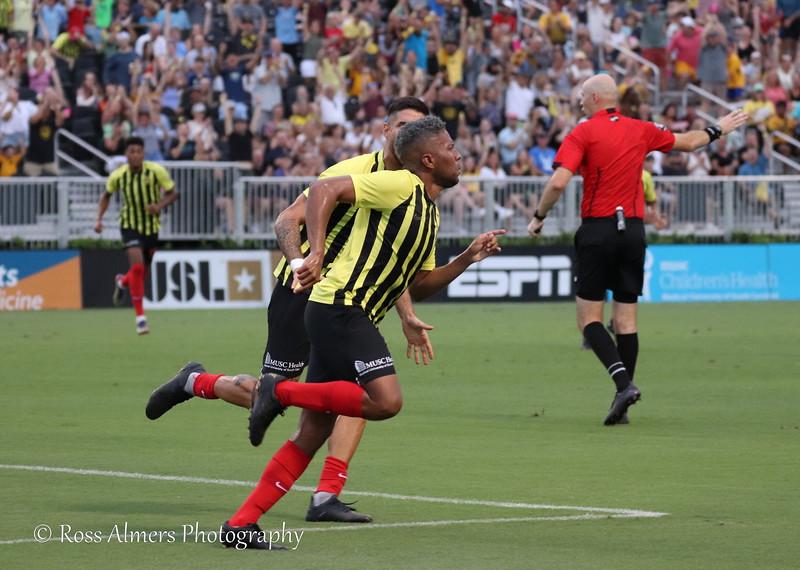 The Battery celebrate a Romario Piggott goal against Hartford Athletic