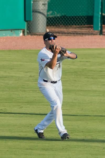 #14 Center Fielder Reid Gorecki catches a fly ball.