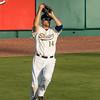 #14 Center Fielder Reid Gorecki catches another fly ball.