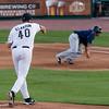 #40 Pitcher Scott Elarton tries to pickoff a Patriot.