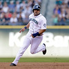 Seattle Mariners' Kendrys Morales heads toward third against the Cleveland Indians in a baseball game Tuesday, July 23, 2013, in Seattle. (AP Photo/Elaine Thompson)
