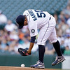 Seattle Mariners staring pitcher Erasmo Ramirez reaches for the ball to start a baseball game against the Cleveland Indians Tuesday, July 23, 2013, in Seattle. (AP Photo/Elaine Thompson)