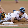 Seattle Mariners' Mike Zunino dives back to first base against the Cleveland Indians in a baseball game Tuesday, July 23, 2013, in Seattle. (AP Photo/Elaine Thompson)