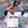 Seattle Mariners starting pitcher Erasmo Ramirez adjusts his cap after giving up a run against the Cleveland Indians in the first inning of a baseball game Tuesday, July 23, 2013, in Seattle. (AP Photo/Elaine Thompson)