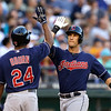 Cleveland Indians' Yan Gomes, right, is greeted by Michael Bourn hitting a two-run home run against the Seattle Mariners in the second inning of a baseball game Tuesday, July 23, 2013, in Seattle. (AP Photo/Elaine Thompson)