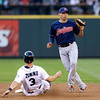 Cleveland Indians shortstop Asdrubal Cabrera, right, waits for the ball as Seattle Mariners' Mike Zunino slides toward second base in a baseball game Tuesday, July 23, 2013, in Seattle. (AP Photo/Elaine Thompson)