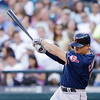 Cleveland Indians' Asdrubal Cabrera drives in a run with a single against the Seattle Mariners in the first inning of a baseball game Tuesday, July 23, 2013, in Seattle. (AP Photo/Elaine Thompson)