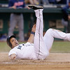 Seattle Mariners' Kendrys Morales is upended at home after being thrown out in a baseball game against the Cleveland Indians Tuesday, July 23, 2013, in Seattle. (AP Photo/Elaine Thompson)