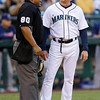 Seattle Mariners bench coach Robby Thompson, right, argues with plate umpire Adrian Johnson in the third inning of a baseball game against the Cleveland Indians on Tuesday, July 23, 2013, in Seattle. Thompson took over for manager Eric Wedge, who remained hospitalized after suffering dizziness before Monday's game. (AP Photo/Elaine Thompson)