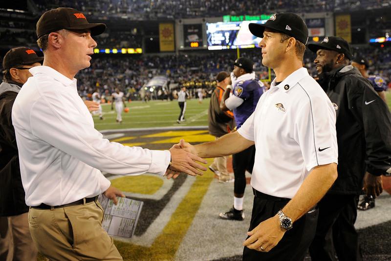 4806fa4e4c0 Cleveland Browns head coach Pat Shurmur shakes hands with Baltimore Ravens  head coach John Harbaugh