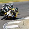 AMA pros Martin Cardenas and Danny Eslick do battle at Barber Motorsports Park during 2010 AMA Championship.