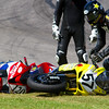 AMA Pro Daytona SportBike Rider Corey West and Jodi Christie pick up the pieces after Barber Motorsports Park wipeout during the 2010 AMA Championships.