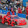 Dale Earnhardt Jr.'s team at work on the #8 Bud car during pit stop at Talladega