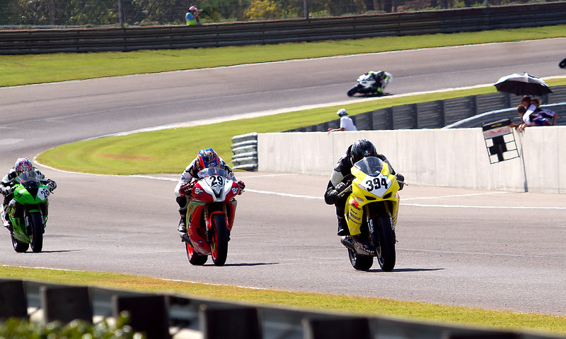 Dellinger, O'Hara, and Kerr race down front stretch at Barber Motorsports Park.