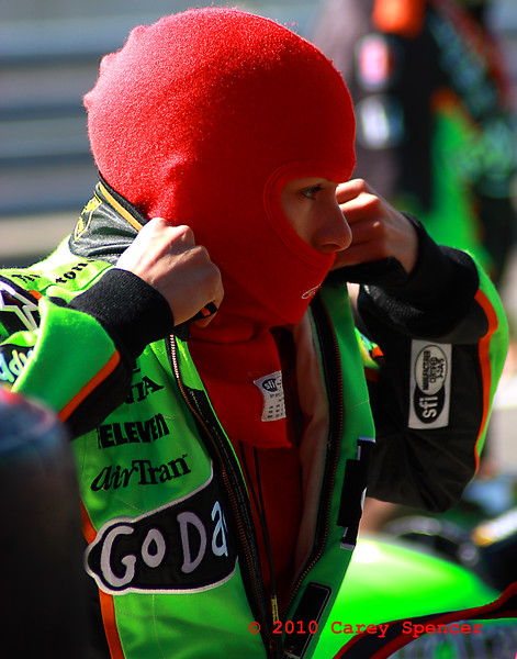 Danica Patrick getting dressed for racing at  Barber Motorsports Park Alabama Indy Grand Prix of Alabama