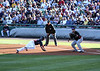 Braves outfielder Jordan Schafer dives back to first.