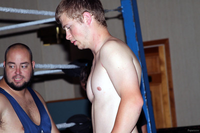 "Eddie Loomis (with ""The Barrington Bulldozer"" John Munroe in the background) at the Northeast Championship Wrestling (NCW) ""Big City Rumble"" event held on August 17, 2012 in West Warwick, Rhode Island."