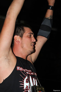 """$$Hi-Lite$$ Davey Cash is victorious in the Crown Jewel Ladder Match during the Renegade Wrestling Alliance (aka RWA Wrestling) """"Thanksgiving Throwdown"""" event held on November 9, 2013 at the Varnum Memorial Armory in East Greenwich, Rhode Island."""