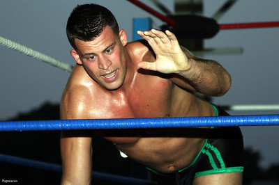 """""""The Sure Thing"""" Mark Shurman reaches for the ropes during his match against """"Hard Hittin"""" Bobby Ocean at the Top Rope Promotions (TRP) Wrestling show held on June 29, 2012 at the Brockton Fair in Brockton, Massachusetts."""