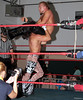 "The Young Bucks' Matt Jackson takes Brian Fury for a ride at the XWA Wrestling ""Retribution"" show held on June 27, 2015 in Cranston, Rhode Island."
