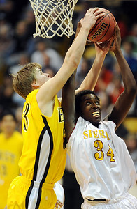 Mitch Secora, left, of Pueblo East, and Wesley Gordon of Sierra, fight for a rebound during the first half of the Colorado 4A State Championship game on March 13, 2010 in Boulder.  Cliff Grassmick / March 13, 2010