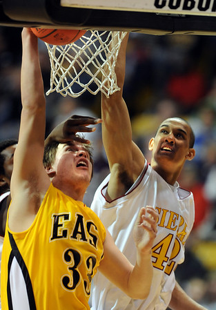 Mitch Secora, left, of Pueblo East, tries to score on Kamryn Williams of Sierra during the firts half of the 4A Colorado State Championship game in Boulder on march 13, 2010.<br /> <br /> Cliff Grassmick / March 13, 2010