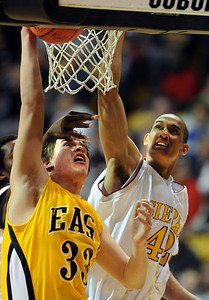 Mitch Secora, left, of Pueblo East, tries to score on Kamryn Williams of Sierra during the firts half of the 4A Colorado State Championship game in Boulder on march 13, 2010.  Cliff Grassmick / March 13, 2010