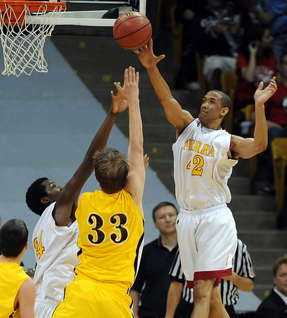 Kamryn Williams, right, of Sierra, blocks the shot of Mitch Secora of Pueblo East.<br /> <br /> Cliff Grassmick / March 13, 2010