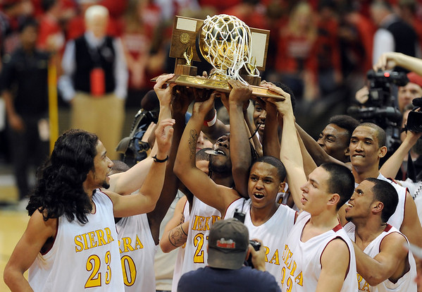 Sierra High School players hold up the 4A Colorado State High School trophy by beating Puebl East for the championship on March 13, 2010 in Boulder.<br /> <br /> Cliff Grassmick / March 13, 2010