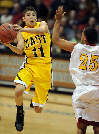 Josh Sandoval of Pueblo East, looks to pass around William Sanaunders of Sierra during the 4A State Championship game in Boulder.<br /> <br /> Cliff Grassmick / March 13, 2010
