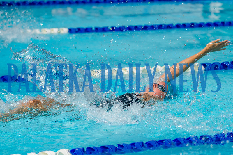Lily Tallerico swims in the 50 Yard Backstroke