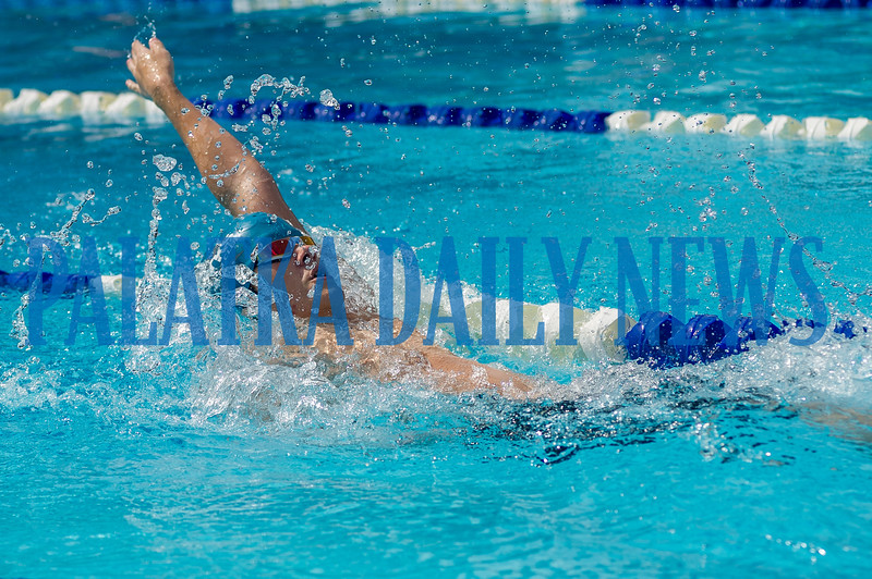 Riley Parsons swims in the 50 Yard Backstroke