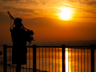 Bagpipes at Sunrise Over the Mississippi River